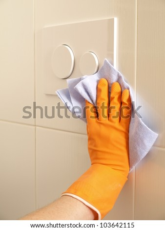 Wiping a bathroom tiles with a soft cloth - stock photo