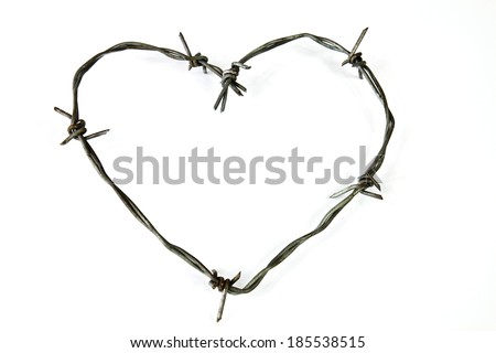 Wire bent in the shape of a heart on a white background - stock photo