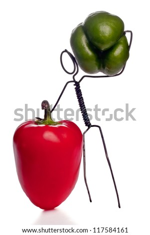 Wire character holding bell peppers advertising vegeterian lifestyle