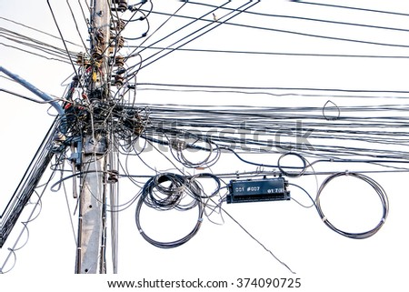 Wire electric at a pole it messy and chaotic - stock photo