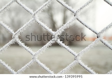 wire fence texture with hoarfrost overlay - stock photo