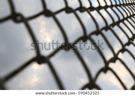 Wire fence with a sky background. Focus sky