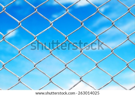 wire fence with blue sky background - stock photo