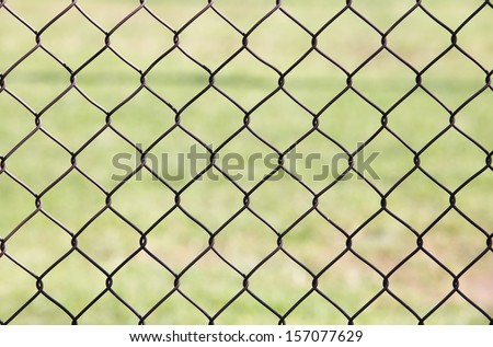 Wire fence with green gress background  - stock photo