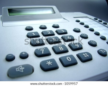 wire phone with rubber buttons and display - stock photo