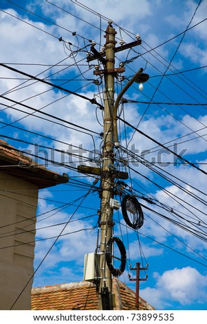 Wire Pole & blue sky - stock photo