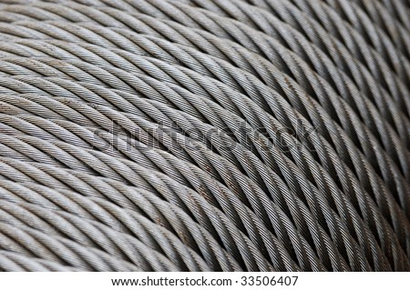 Wire rope texture - heavy duty steel wire cable or rope as background. Coils of wire rope or cable used in the fishing industry. Coil steel wire rope. Close up of steel wire rope cable. - stock photo