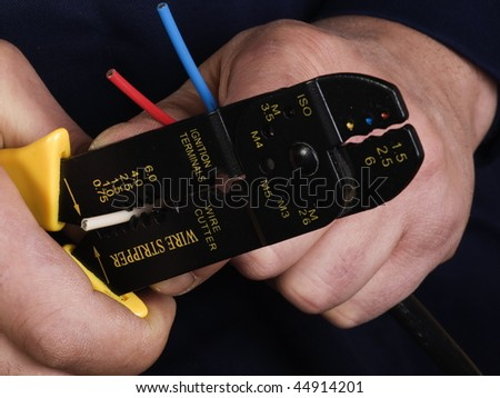 wire stripper   in the hands of worker - stock photo
