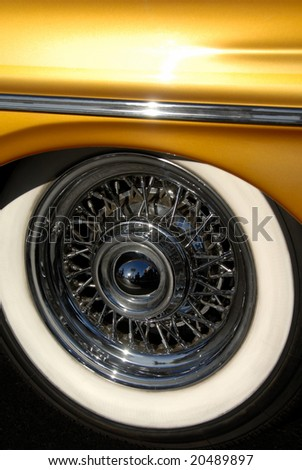 wire wheels and whitewall tire on vintage retro antique automobile