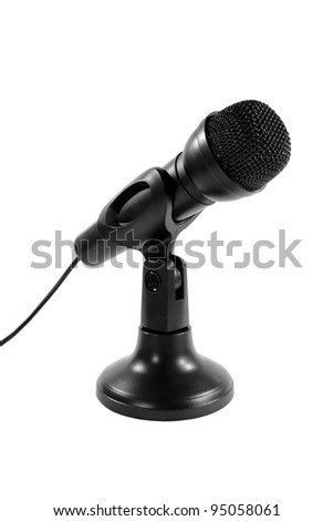 Wired black microphone on a stand isolated on white. - stock photo