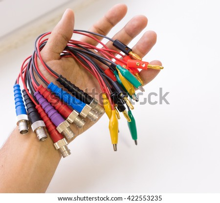 Wired BNC-connectors, banana plugs and crocodile clips - stock photo