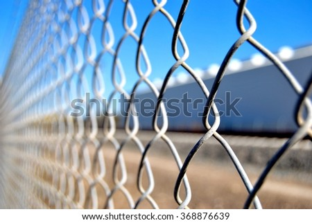 Wired fence on blue sky background - stock photo