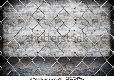 Wired fence pattern on grunge background - stock photo