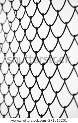 Wired mesh cage shallow dof. - stock photo