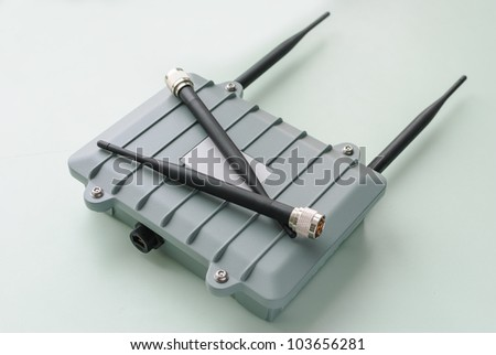 Wireless access point for outdoor installation with two antennas on the body. - stock photo