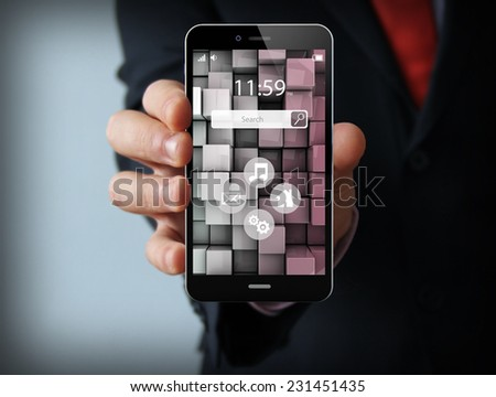 wireless communications concept: businessman holding a modern smartphone with touchscreen interface - stock photo