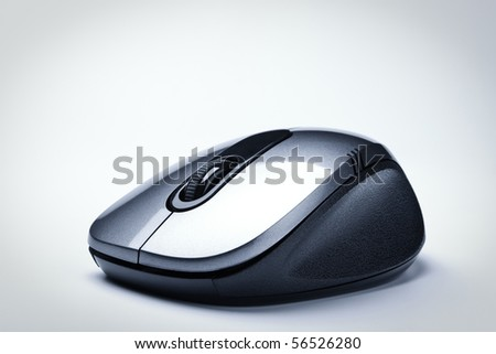wireless computer mouse, grey background - stock photo