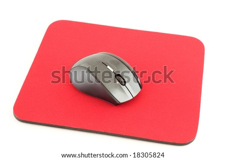 Wireless computer mouse on red mouse pad isolated on white background - stock photo