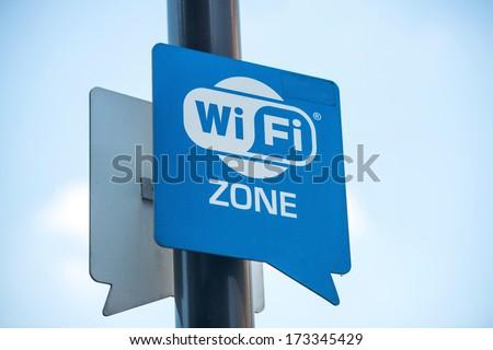 Wireless internet sign on pole on the street - stock photo