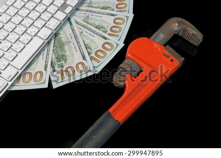 Wireless Keyboard, USA Dollars Cash and Adjustable Wrench Isolated On Black Glass Background With Reflection High Angle View Close-up. Technical Support Or Warranty Service Concept - stock photo