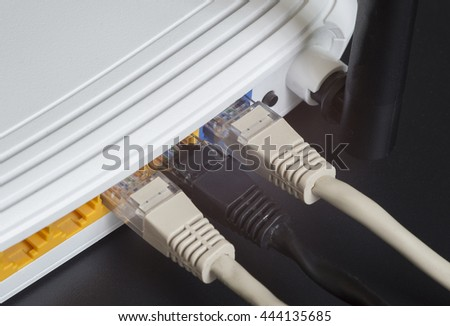 Wireless lan router with network cable - stock photo
