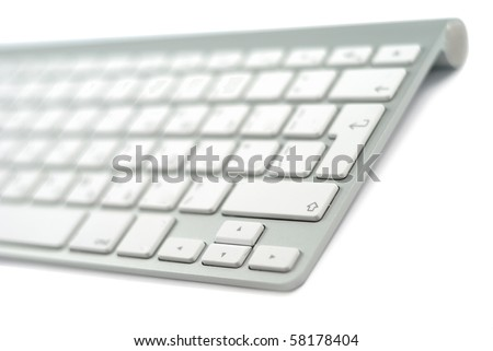 Wireless metallic keyboard isolated over white background