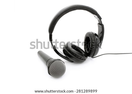 Wireless microphone and headphones on a white background - stock photo
