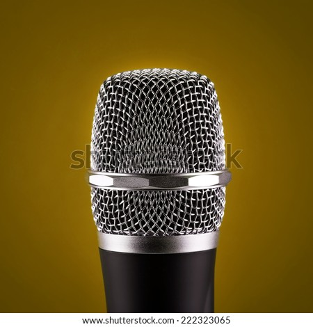 Wireless microphone closeup on yellow background