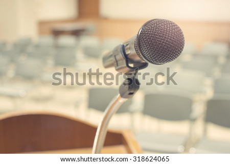 Wireless Microphone in conference room,soft focus effect  - stock photo
