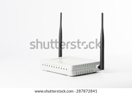 Wireless modem router network hub on white background - stock photo
