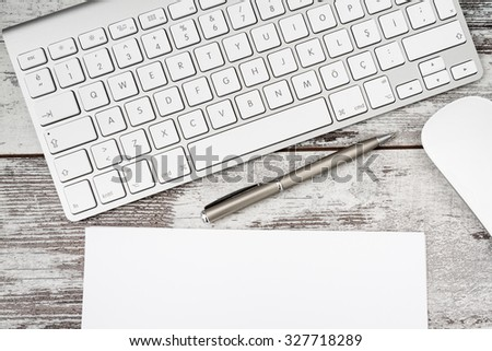 Wireless modern computer keyboard with the Turkish alphabet and white mouse - stock photo