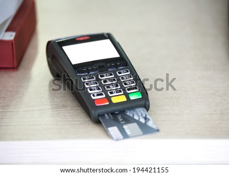wireless pos terminal with card waiting for pin - stock photo