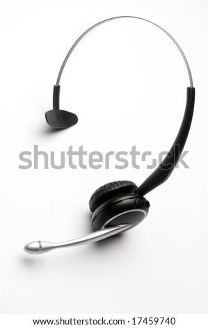 Wireless Telephone Headset on White Background - stock photo