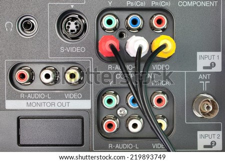 Wires plugged in to the connection panel of tv player - stock photo