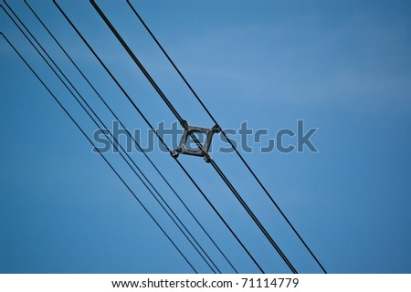 Wires that form part of a high voltage transmission line.