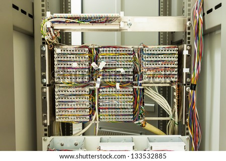 Wiring from rear of server rack - stock photo