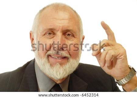 Wise businessman talking and teaching while pointing his finger; isolated on white