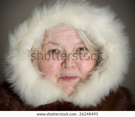 Wise Chukchi woman cheerful looking at the camera - stock photo