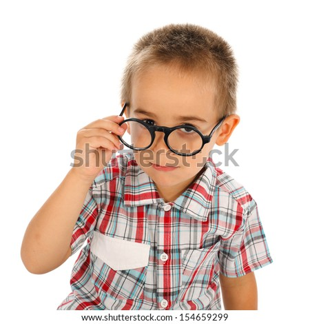 Wise little boy looking through big glasses