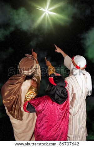 Wise men Caspar Melchior and Balthasar following the star of Bethlehem - stock photo