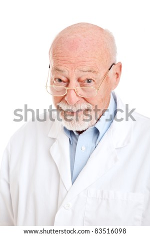 Wise senior man in a labcoat.  Could be pharmacist, doctor, or scientist.  Isolated on white. - stock photo