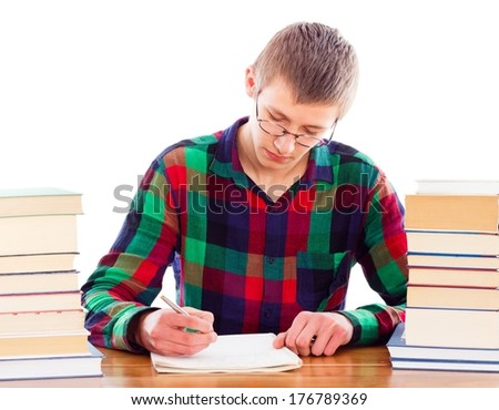 Wise student writing his homework patiently. - stock photo