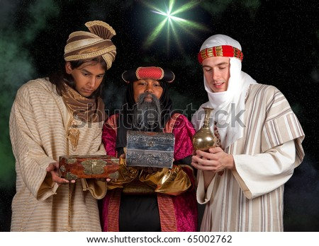Wisemen Caspar Melchior and Balthasar and their gifts for Jesus - stock photo