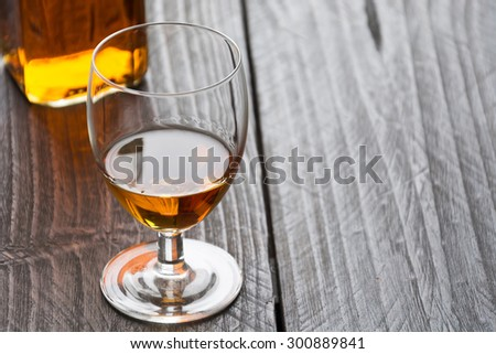 wisky glass  on wood table