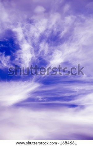 Wispy cirrus clouds in a blue sky - stock photo