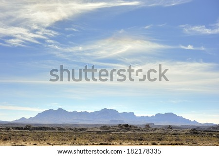 Wispy Clouds above the Chisos Mountains - Big Bend National Park - stock photo