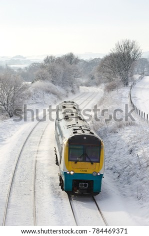 WISTANSTOW, UK - DECEMBER 12: An Arriva operated DMU express passenger commuter service heads towards Shrewsbury having departed Cardiff on December 12, 2017 in Wistanstow
