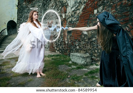 witch and angel magical battle between