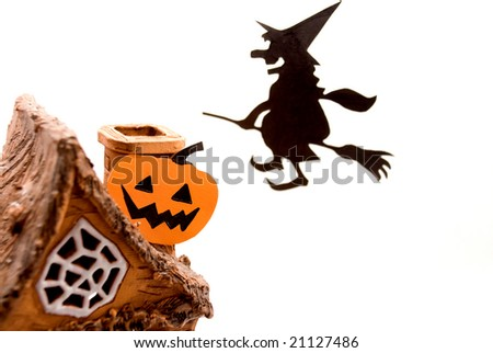 Witch and the house with a pumpkin
