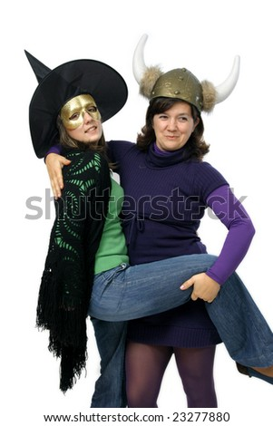witch and viking woman playing and smiling - stock photo
